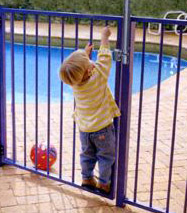 Locked gate foiling child's attempt to enter pool