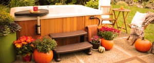 Hot tub in fall surrounded by pumpkins