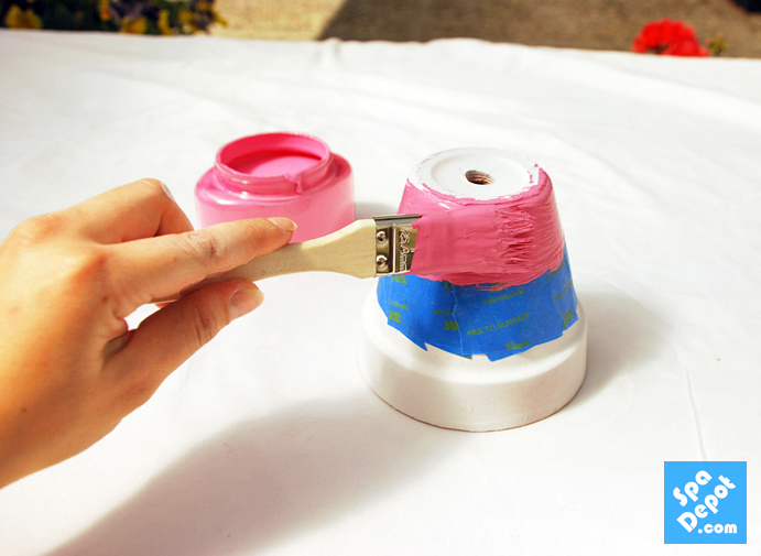 Tape your pots with painters tape to create fun designs