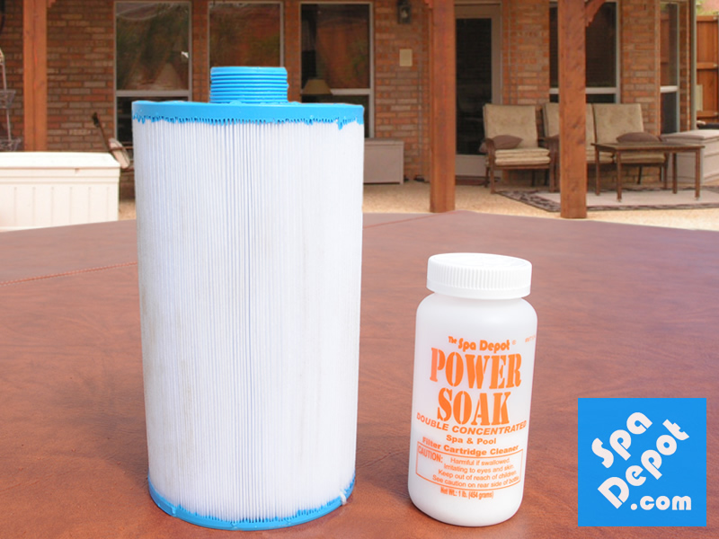 Clean filter next to a bottle of Power Soak filter cleaner