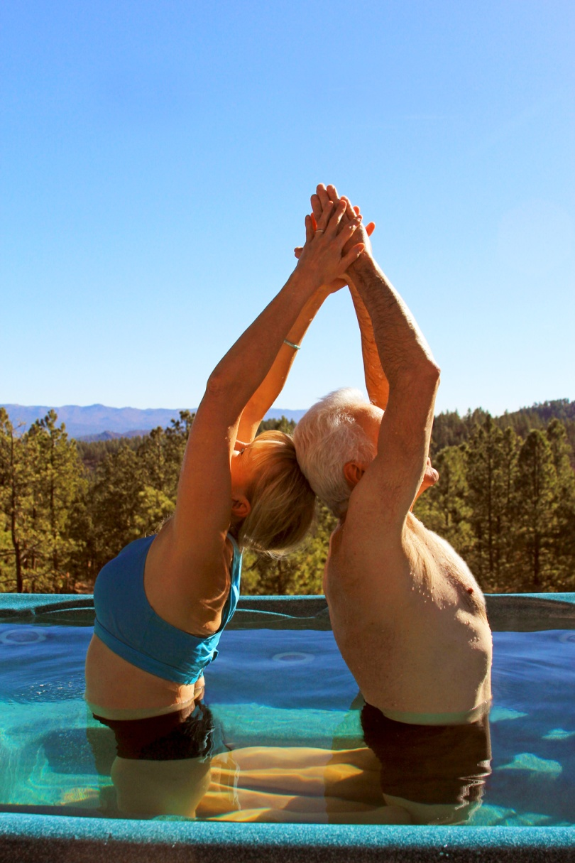 Susan-Atkinson-and-partner-doing-yoga-poses-in-hot-tub