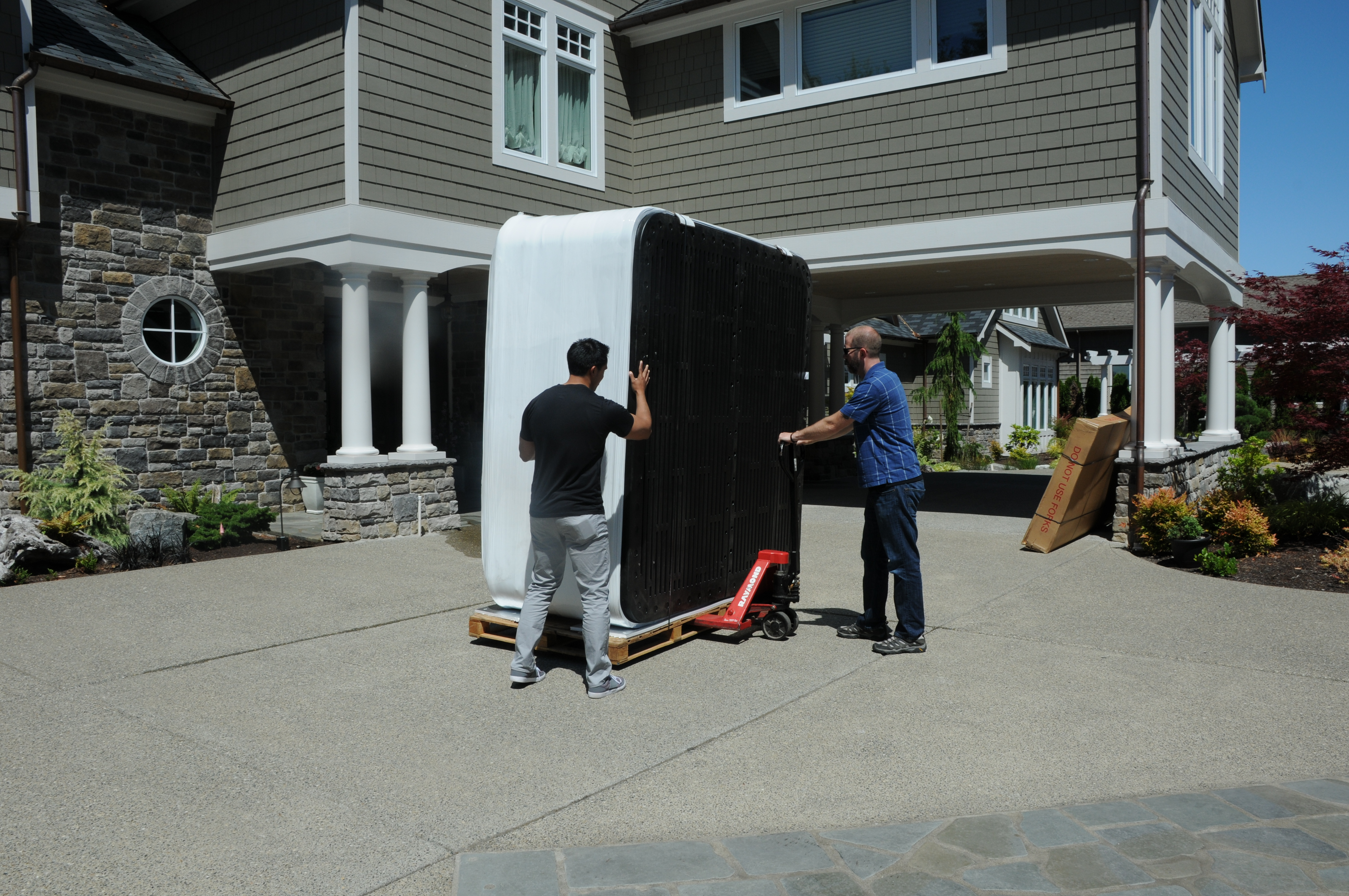 hot tub being moved using a pallet jack