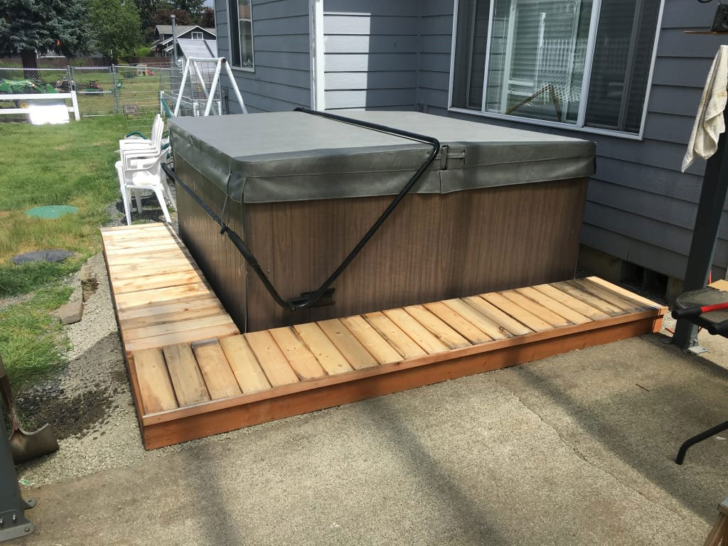 Spa on gravel base with mini deck surrounding