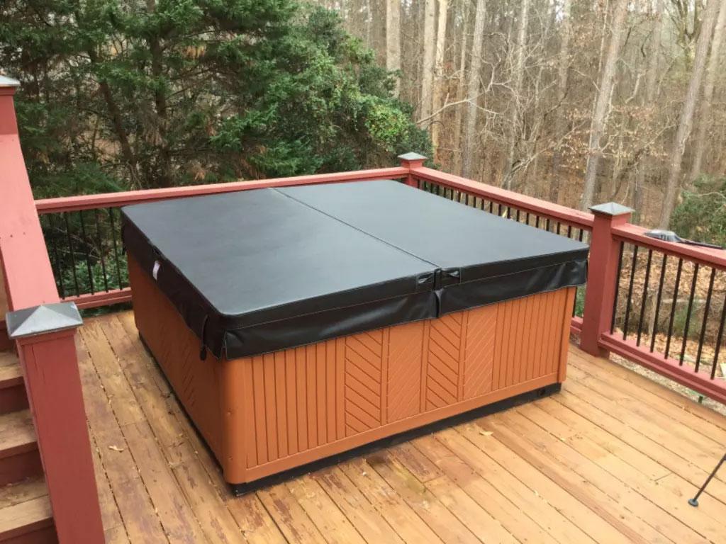 Beautiful hot tub sitting on elevated wood deck