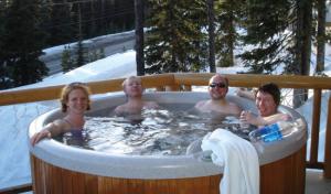 people enjoying winter hot tubbing