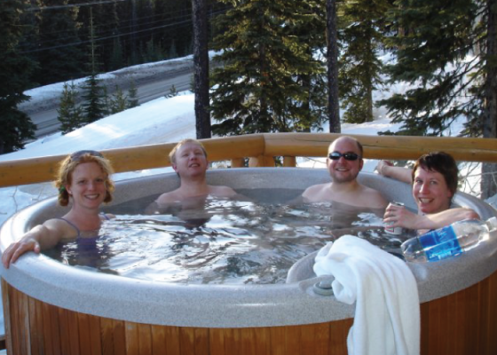 people enjoying winter hot tubbing