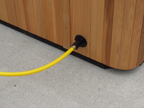 hot tub drain valve with yellow garden hose attached