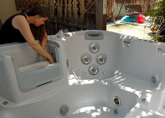 woman cleaning and installing filter in hot tub