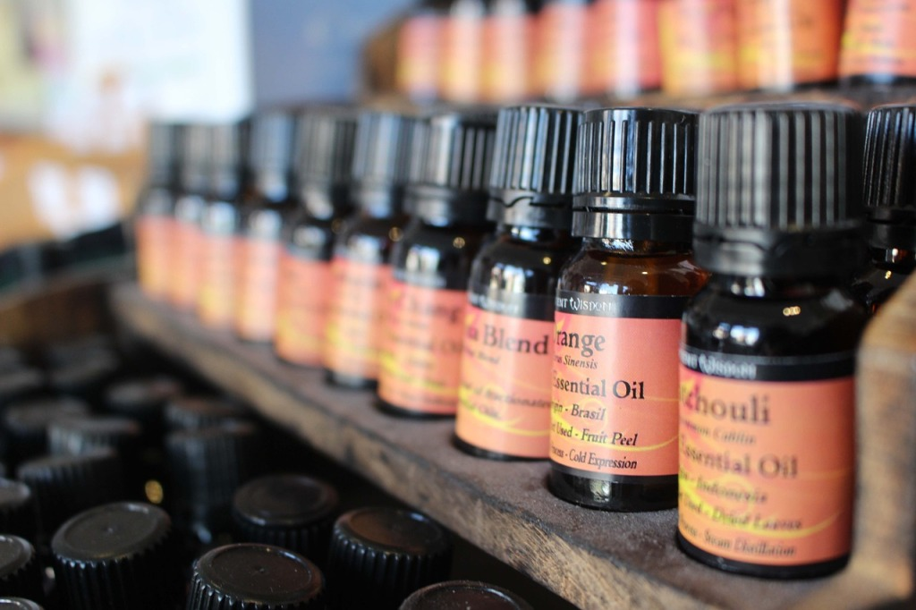 variety of essential oil ampoules on store shelf